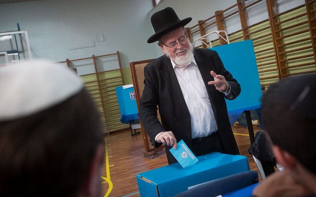 An ultra-Orthodox man casts his vote at a polling station in Jerusalem on March 17, 2015. (Photo credit: Miriam Alster/FLASH90)