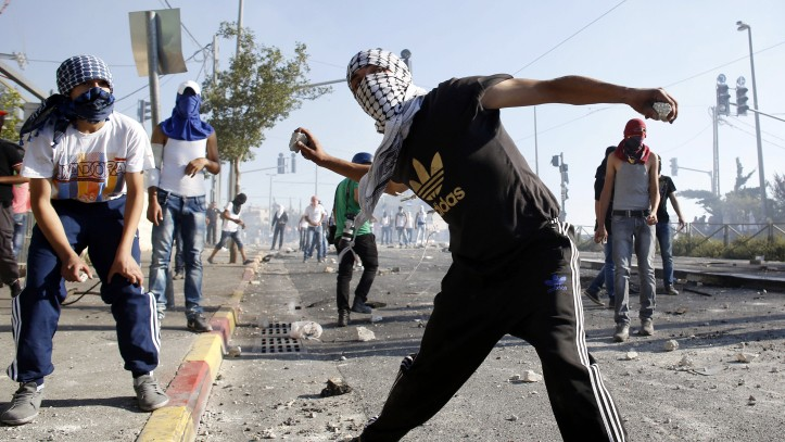 Palestinian youth throw stones at Israeli police during a riot in East Jerusalem, in July 2014. (Photo credit: Sliman Khader/Flash90)