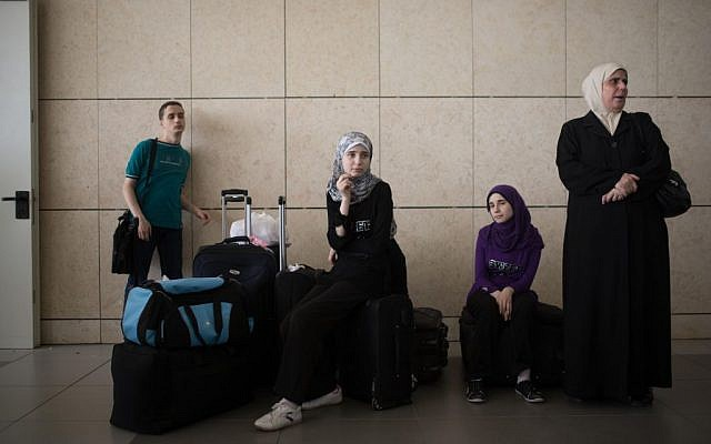 Palestinians wait at the Erez Crossing between Gaza and Israel, July 13, 2014 (photo credit: Flash90)
