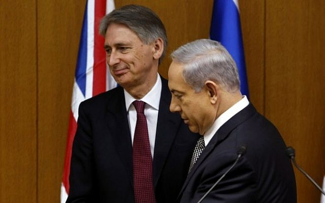 Prime Minister Benjamin Netanyahu with British Foreign Secretary Philip Hammond during a joint press conference at the Israeli Knesset, in Jerusalem on July 24, 2014. (Photo credit: Flash90)