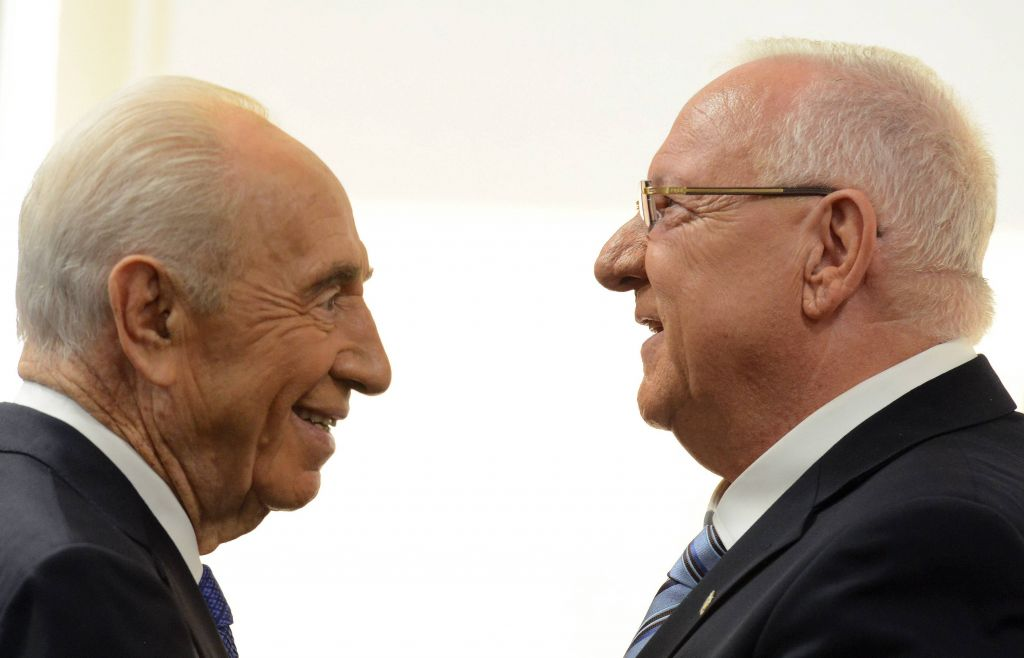 President Reuven Rivlin speaks with outgoing president, Shimon Peres, after being sworn in as the tenth president of Israel in a ceremony at the Knesset Plenum on Thursday, July 24, 2014. Photo credit: Haim Zach/GPO/Flash90)