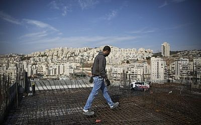 A construction worker next to the East Jerusalem neighborhood of Har Homa in October, 2014. (Hadas Parush/Flash90)