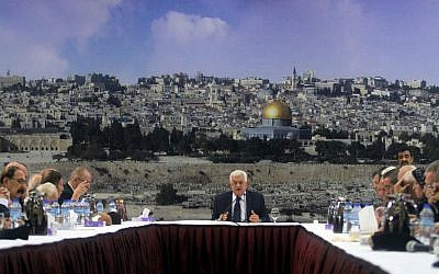 Mahmoud Abbas speaks during a meeting of the Palestinian leadership in the West Bank city of Ramallah to discuss canceling security coordination with Israel on December 14, 2014. Behind him is a view of Jerusalem's Old City (Photo credit: FLASH90)