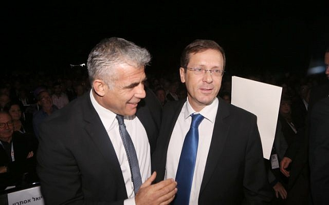 Yesh Atid party leader Yair Lapid (L) and Zionist Union party leader Isaac Herzog on December 24, 2014. (photo credit: Flash90)