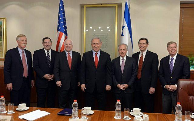 Benjamin Netanyahu meeting with US senators in Jerusalem on January 19, 2015. (photo credit: Haim Zach / GPO)