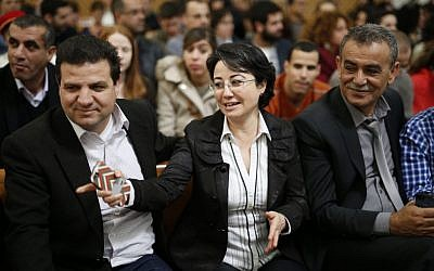 Arab-Israeli parliament member Hanin Zoabi accompanied by Ayman Odeh (L) and MK Jamal Zahalka seen in the Supreme Court in Jerusalem where she appealed a decision by the Central Election Committee to disqualify her from running in the upcoming Israeli elections, February 17, 2015 (David Vaaknin/Flash90)