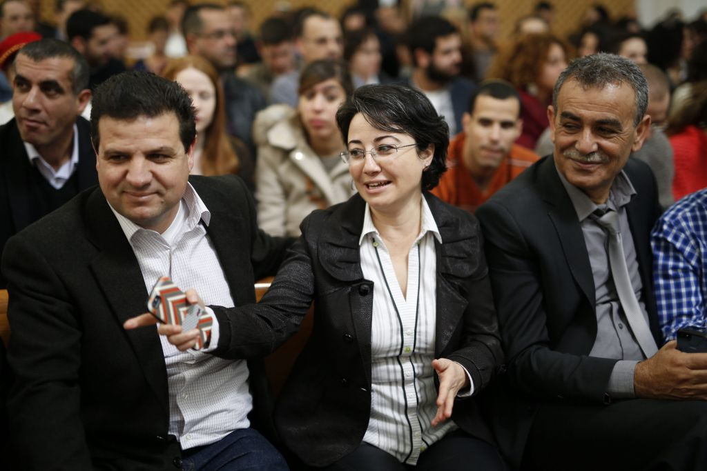 Arab-Israeli parliament member Hanin Zoabi accompanied by Ayman Odeh (L) and MK Jamal Zahalka seen in the Supreme Court in Jerusalem where she appealed a decision by the Central Election Committee to disqualify her from running in the upcoming Israeli elections, February 17, 2015 (photo credit: David Vaaknin/Flash90)