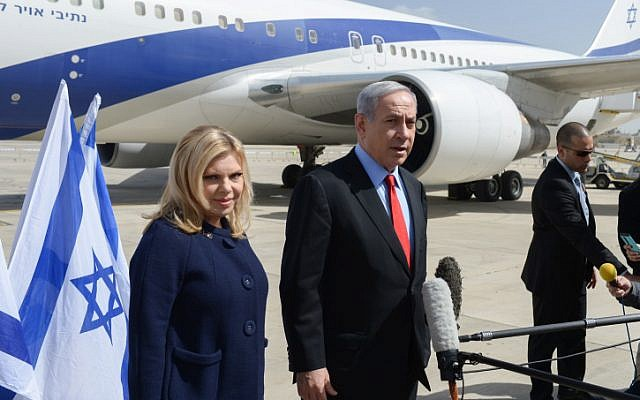 Prime Minister Benjamin Netanyahu and his wife, Sara Netanyahu, seen at Ben Gurion Airport, Tel Aviv, as they depart for the United States on Sunday, March 1, 2015, ahead of Netanyahu speech this week at the US Congress. (Photo credit: Amos Ben Gershom / GPO)
