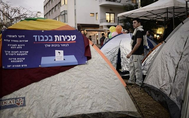 Israeli social activists seen near tents on Rothschild Boulevard in Tel Aviv on March 1, 2015. Israeli social activists pitched tents in Tel Aviv Rothschild Boulevard on Sunday, protesting against the high cost of living and housing. (Photo by Tomer Neuberg/Flash90)
