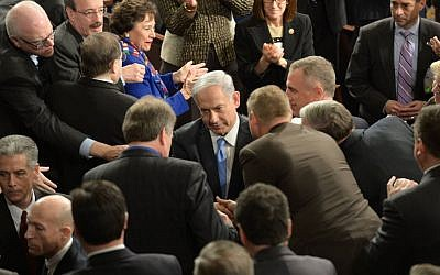 Prime Minister Benjamin Netanyahu is greeted by members of Congress prior to addressing a joint session on Capitol Hill in Washington DC, March 03, 2015. (photo credit: Amos Ben Gershom/ GPO)