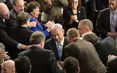 Prime Minister Benjamin Netanyahu is greeted by members of Congress on Capitol Hill in Washington, DC, March 3, 2015. (Amos Ben Gershom/GPO)