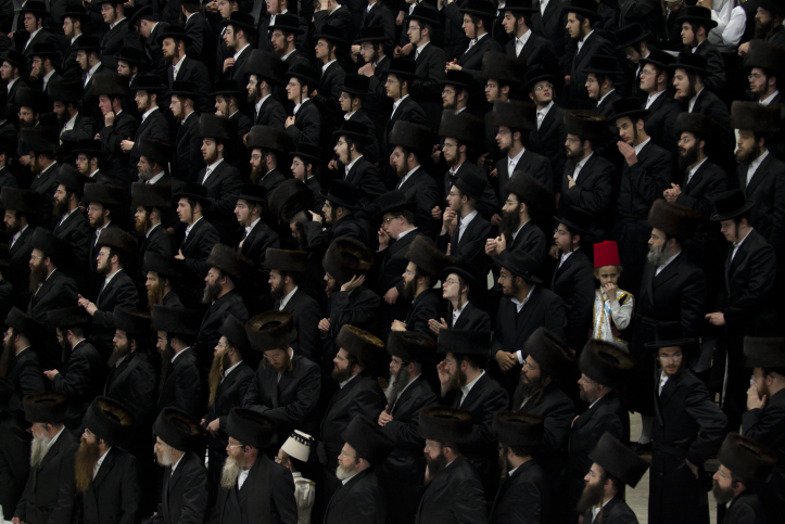 Ultra Orthodox Jewish men and children of the Vizhnitz chassidic dynasty seen during the reading of the Scroll of Esther in Bnei Brak on Wednesday night, March 4, 2015. (photo credit: Amir Levy/Flash90)