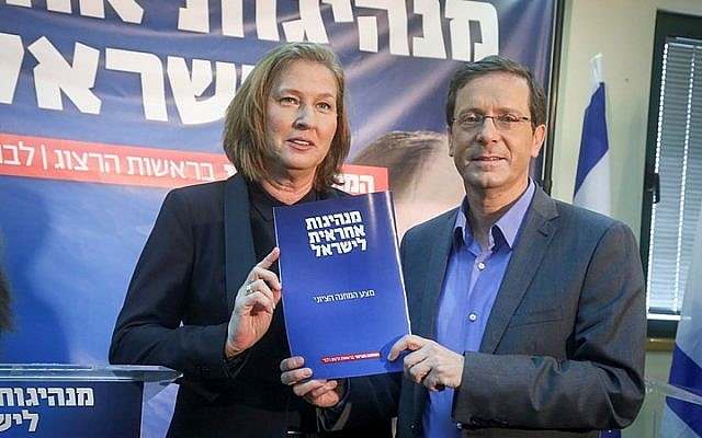 Tzipi Livni (left) and Isaac Herzog (right) of the Zionist Union present their party's 'Responible Leadership in Israel' agenda, at a press conference in Tel Aviv on March 8, 2015. (photo credit: Flash90)