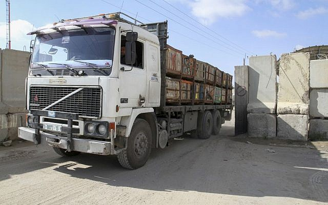 A Palestinian trucks loaded with goods entering the Gaza Strip from Israel through the Kerem Shalom crossing in Rafah in southern Gaza Strip, March 15, 2015 (photo credit: Abed Rahim Khatib/Flash90)