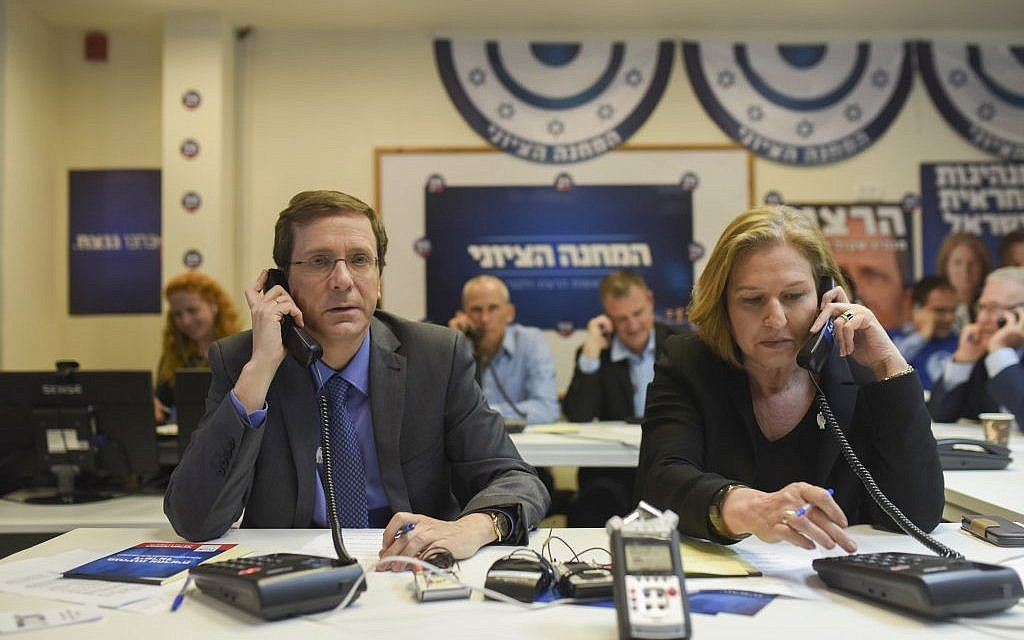 Zionist Union list leaders Isaac Herzog and Tzipi Livni talk to potential voters ahead of the election, at the party headquarters in Tel Aviv, on March 15, 2015 (photo credit: Ben Kelmer/Flash90)