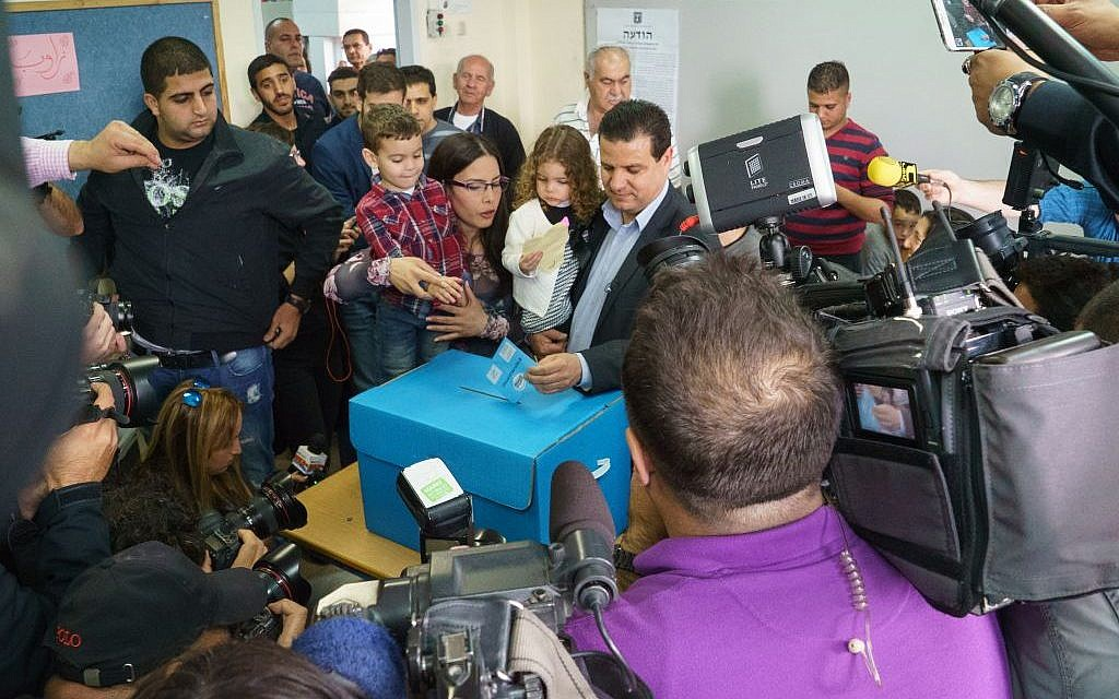 Joint List head Ayman Odeh voting in Nazareth on March 17, 2015. (Photo credit: Basal Awidat/Flash90)