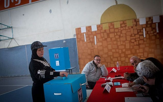 An Israeli Arab woman casts her vote at a polling station in the Arab neighborhood of Beit Safafa, in Jerusalem on Tuesday, March 17, 2015 (photo credit: Miriam Alster/FLASH90)