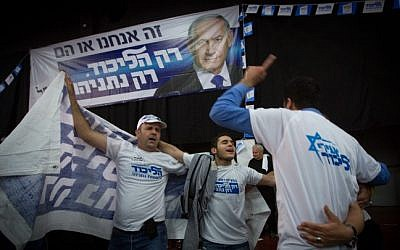 Likud supporters celebrate at party headquarters in Tel Aviv on March 18, 2015. (Miriam Alster/Flash90)