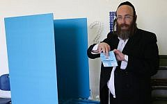An ultra-Orthodox man casts his vote at a polling station in the settlement of Beitar Illit in the Israeli general elections for the 20th parliament, March 17, 2015. (photo credit: Nati Shohat/FLASH90)