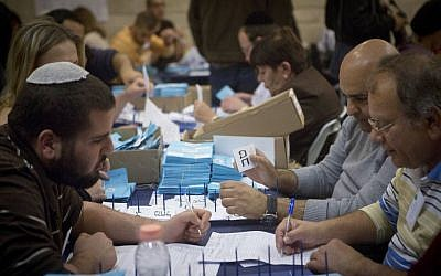 Officials count the final ballots, from soldiers and absentees, a day after the general elections, March 18, 2015. (Miriam Alster/Flash90