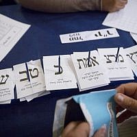 Counting ballots from soldiers and absentees at the Knesset in Jerusalem, a day after the general elections, March 18, 2015. (Photo credit: Miriam Alster/FLASH90)