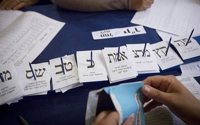 Israelis count the remaining ballots from soldiers and absentees at parliament in Jerusalem, a day after the general elections for the 20th Israeli Knesset. March 18, 2015. (Photo credit: Miriam Alster/FLASH90)