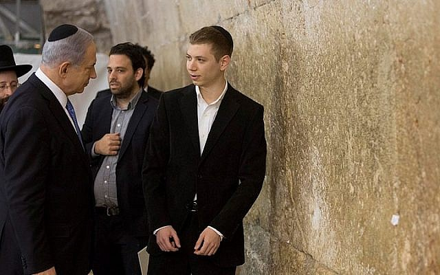 Prime Minister Benjamin Netanyahu and his son Yair visit the Western Wall in Jerusalem's Old City, a day after the elections on March 18, 2015. (photo credit: Yonatan Sindel/Flash90)