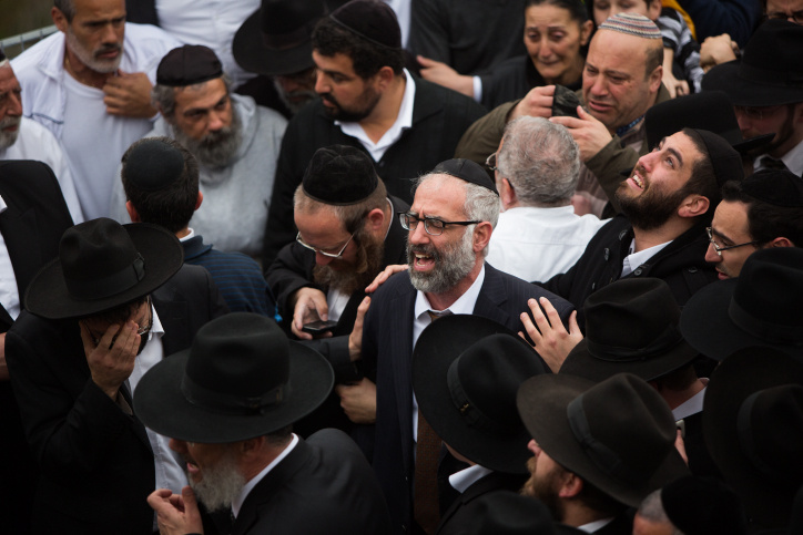 Gabriel Sassoon at the funeral of his seven children in Jerusalem on March 23, 2015. (photo credit: Yonatan Sindel/Flash90)
