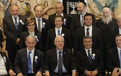Prime Minister Benjamin Netanyahu and President Reuven Rivlin pose with heads of all the Israeli political parties after the opening session of the 20th Knesset on March 31, 2015. (Miriam Alster/Flash90)