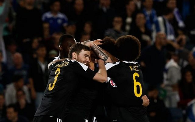 Belgian players celebrate the only goal of their Euro 2016 qualifying match against Israel at the Teddy Stadium in Jerusalem, on March 31, 2015. (Photo credit: Yonatan Sindel/Flash90)