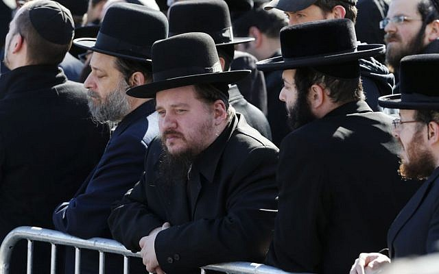 Mourners gather during funeral services for the seven siblings killed in a house fire, Sunday, March 22, 2015, in the Brooklyn borough of New York. (photo credit: AP/Julio Cortez)