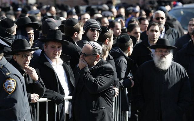 Mourners attend funeral services for the seven siblings killed in a house fire, Sunday, March 22, 2015, in the Brooklyn borough of New York. (photo credit: AP/Julio Cortez)