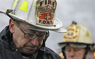 New York's Fire Commissioner Daniel Nigro describes the fire to reporters during a news conference, Saturday, March 21, 2015, in the Brooklyn borough of New York, Saturday, March 21, 2015. (photo credit: AP/Mary Altaffer)
