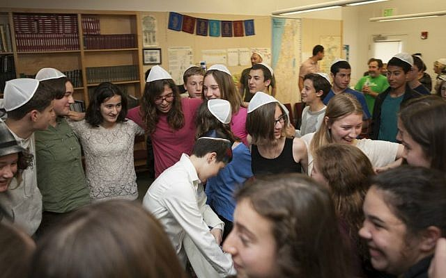 Tom Chai Sosnik's classmates dance with him following ceremony at Tehiyah Day School marking his transition from female to male, March 13, 2015. (photo credit: Misha Bruk, BrukStudios.com)