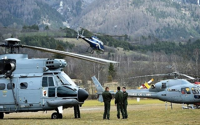 Helicopters of the French Air Force (back) and civil security services are seen in Seyne, south-eastern France, on March 24, 2015, near the site where a Germanwings Airbus A320 crashed in the French Alps.  (photo credit: AFP PHOTO / ANNE-CHRISTINE POUJOULAT
