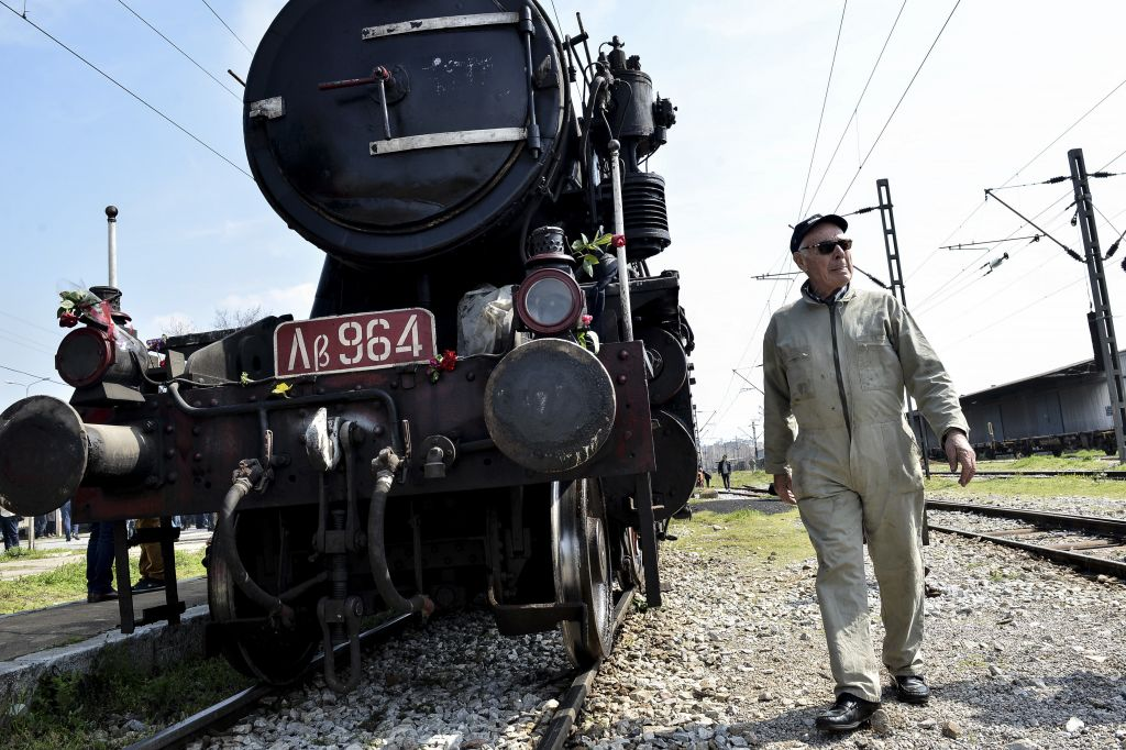 A Hellenic Railway officer walks in front of a train that was used by the Nazis to carry Jews from Thessaloniki to Auschwitz during the WWII, in the Greek northern town of Thessaloniki, on Sunday, March 15, 2015 (AP Photo/Giannis Papanikos)
