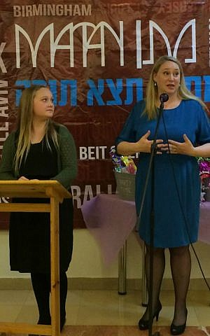 Hannah Bentow looks on as her mother Mette speaks at Hannah's bat mitzvah party in Jerusalem, March 12, 2015. (photo credit: Renee Ghert-Zand/Times of Israel staff)