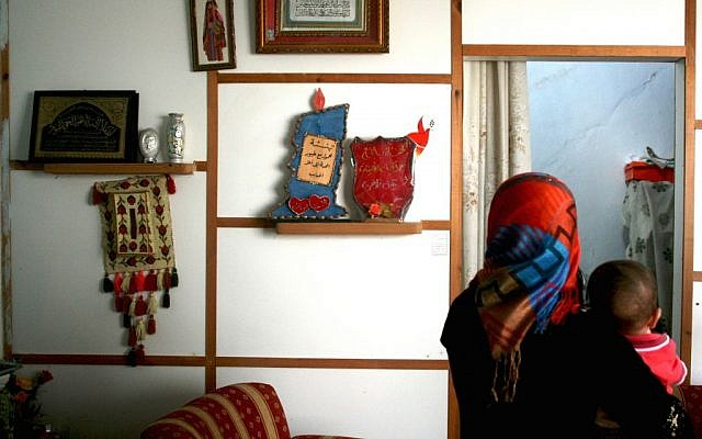 A craftswoman at Om Ahmed's house (photo credit: Shaina Shealy/Times of Israel)