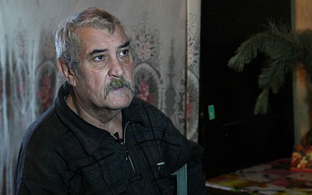 In Artemovsk, homebound pensioner Leonid Annov, 67, lives with his wife and grandson in an uninsulated apartment in eastern Ukraine. (courtesy JDC)