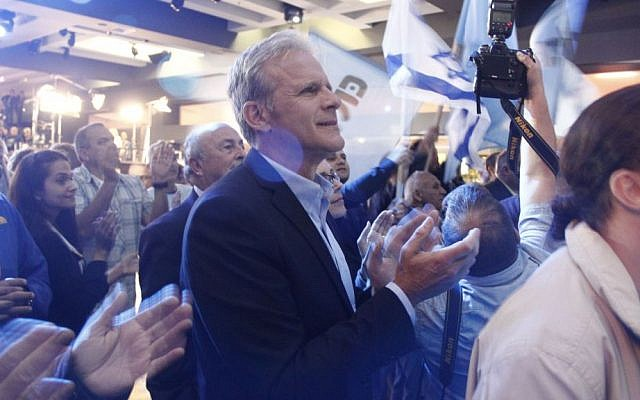 Michael Oren, number four on the Kulanu party's list, applauds as exit polls show his party is slated to receive between nine and ten seats in the 20th Knesset on March 17, 2015. It wound up with 10. (Photo credit: Judah Ari Gross/Times of Israel)