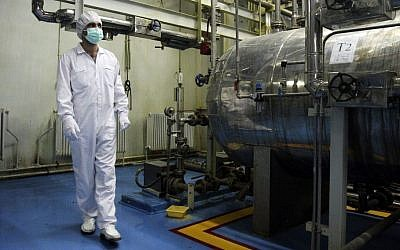 An Iranian technician walks through the Uranium Conversion Facility just outside the city of Isfahan, Iran, February 3, 2007. (photo credit: AP/Vahid Salemi)