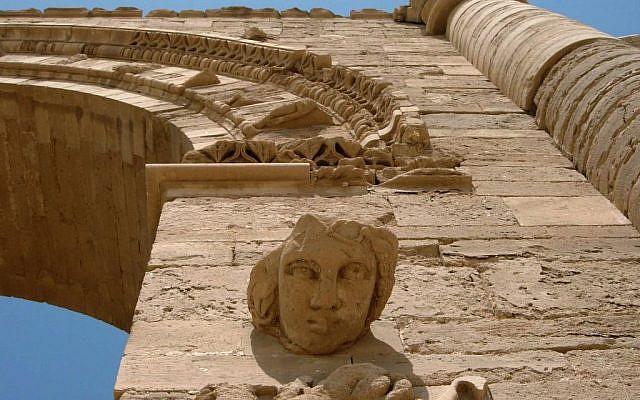 In this July 27, 2005 file photo, the face of a woman stares down at visitors in the Hatra ruins, 320 kilometers (200 miles) north of Baghdad, Iraq. Iraq's minister of tourism and antiquities told The Associated Press, Saturday, March 7, 2015, that the government is investigating reports that the ancient archaeological site of Hatra in northwestern Iraq is being demolished by militants from the Islamic State group (photo credit: AP Photo/Antonio Castaneda)