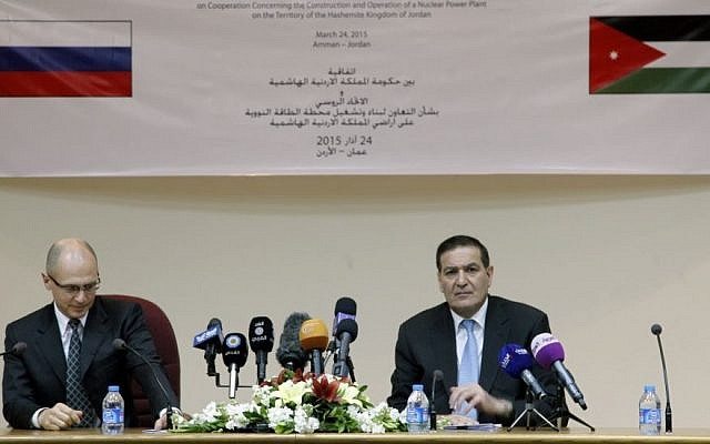 Khalid Toukan, right, chairman of the Jordanian Atomic Energy Commission and Sergei Kiriyenko, of the Russian state nuclear energy agency Rosatom, answer questions from reporters after signing a deal to build Jordan's first nuclear power plant on Tuesday, March 24, 2015, in Amman, Jordan. (Photo credit: AP/Sam McNeil)
