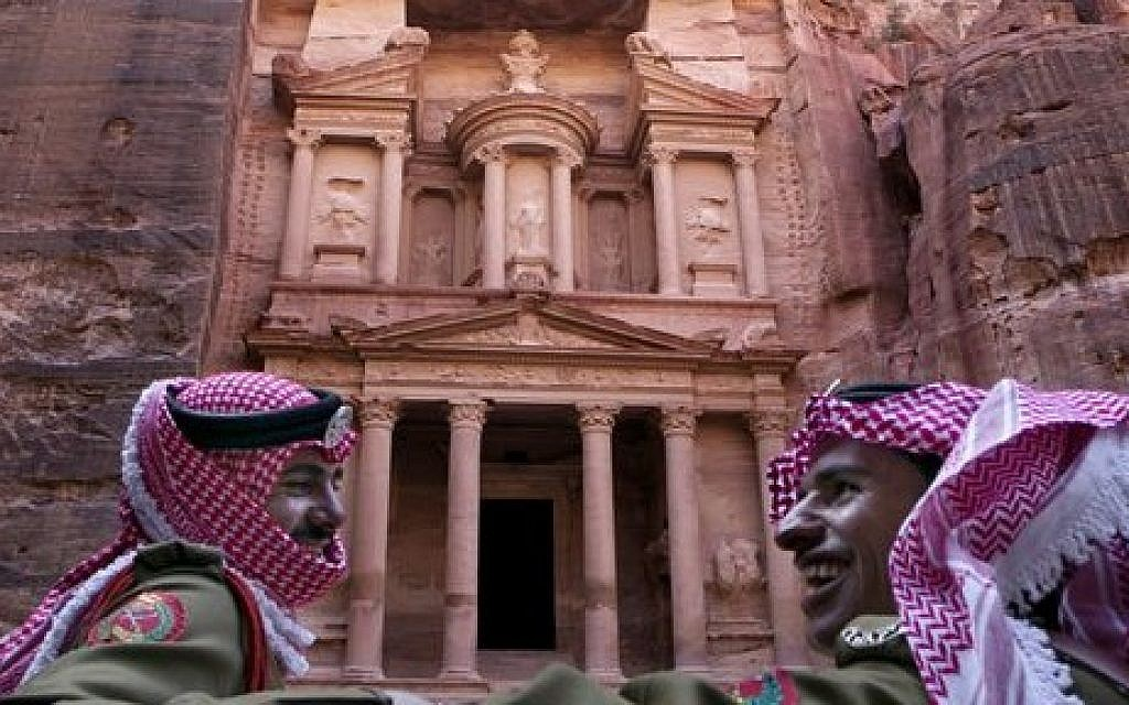 Jordanian royal desert forces stand guard in front of Al Khazneh, Arabic for the Treasury, the most dramatic of many facades carved into the mountains, in the ancient city of Petra, Jordan. March 24, 2015 (photo credit: AP/Raad Adayleh)
