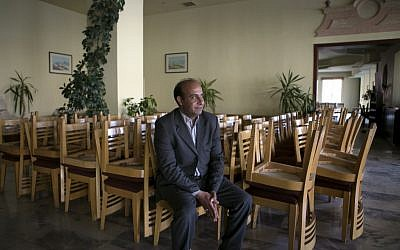 "Ahmad Amarat, manager of the Kings' Way Hotel, speaks during an interview with The Associated Press in the ancient city of Petra, Jordan. ""We are not optimistic for 2015,"" Amarat said. The hotel closed four months ago after an average occupancy rate of 28 percent for 2014, compared to 95 percent in 2010. March 24, 2015 (photo credit: AP/Raad Adayleh)"