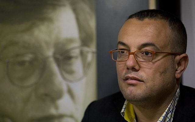 Palestinian novelist Atef Abu Saif in the West Bank city of Ramallah, March 1, 2015. (photo credit: AP/Nasser Nasser)
