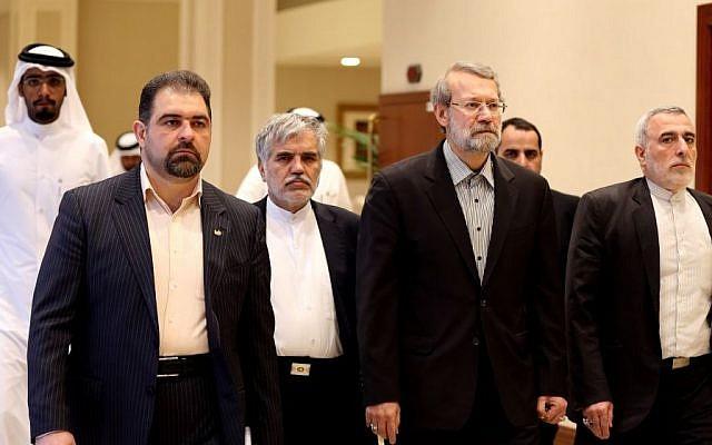 Iranian Parliament Speaker Ali Larijani, center, arrives to address a press conference in Doha, Qatar,Wednesday, March 11, 2015.  (Photo credit: AP/Osama Faisal)