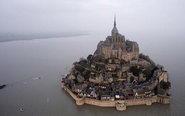 An aerial view as a high tide submerges a narrow causeway leading to the Mont Saint-Michel, on France's northern coast, Saturday, March 21, 2015. (photo credit: AP Photo)