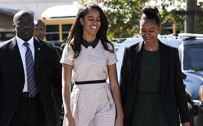 Malia Obama, left, and sister Sasha Obama laugh together as they leave a speech by their father, President Barack Obama, at the Edmund Pettus Bridge in Selma, Alabama, on the 50th anniversary of 'Bloody Sunday,' a landmark event of the civil rights movement, Saturday, March 7, 2015 (AP Photo/Jacquelyn Martin)