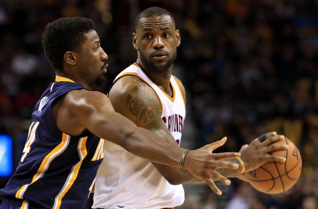 Cleveland Cavaliers LeBron James is guarded by Indiana Pacers Solomon Hill during the fourth quarter of a NBA basketball game Friday March 20, 2015 in Cleveland. (AP Photo/Aaron Josefczyk)